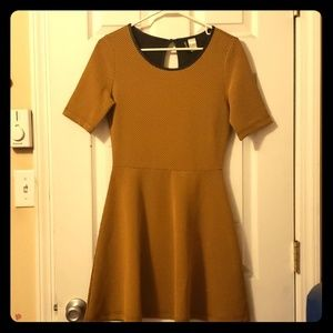 An A-line Retro, Mustard, raised texture dress